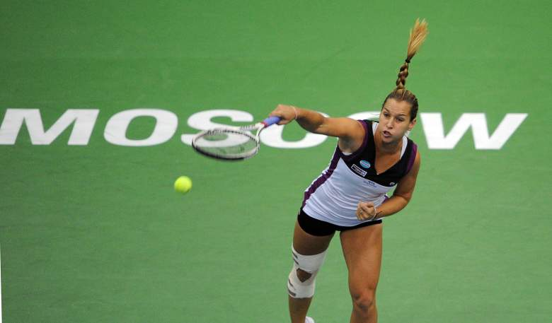 Dominika Cibulkova of Slovakia returns a ball to Elena Vesnina of Russia during the Kremlin Cup tennis tournament semi-final match on October 22, 2011. AFP PHOTO/ ANNA SHEVELYOVA (Photo credit should read ANNA SHEVELYOVA/AFP/Getty Images)