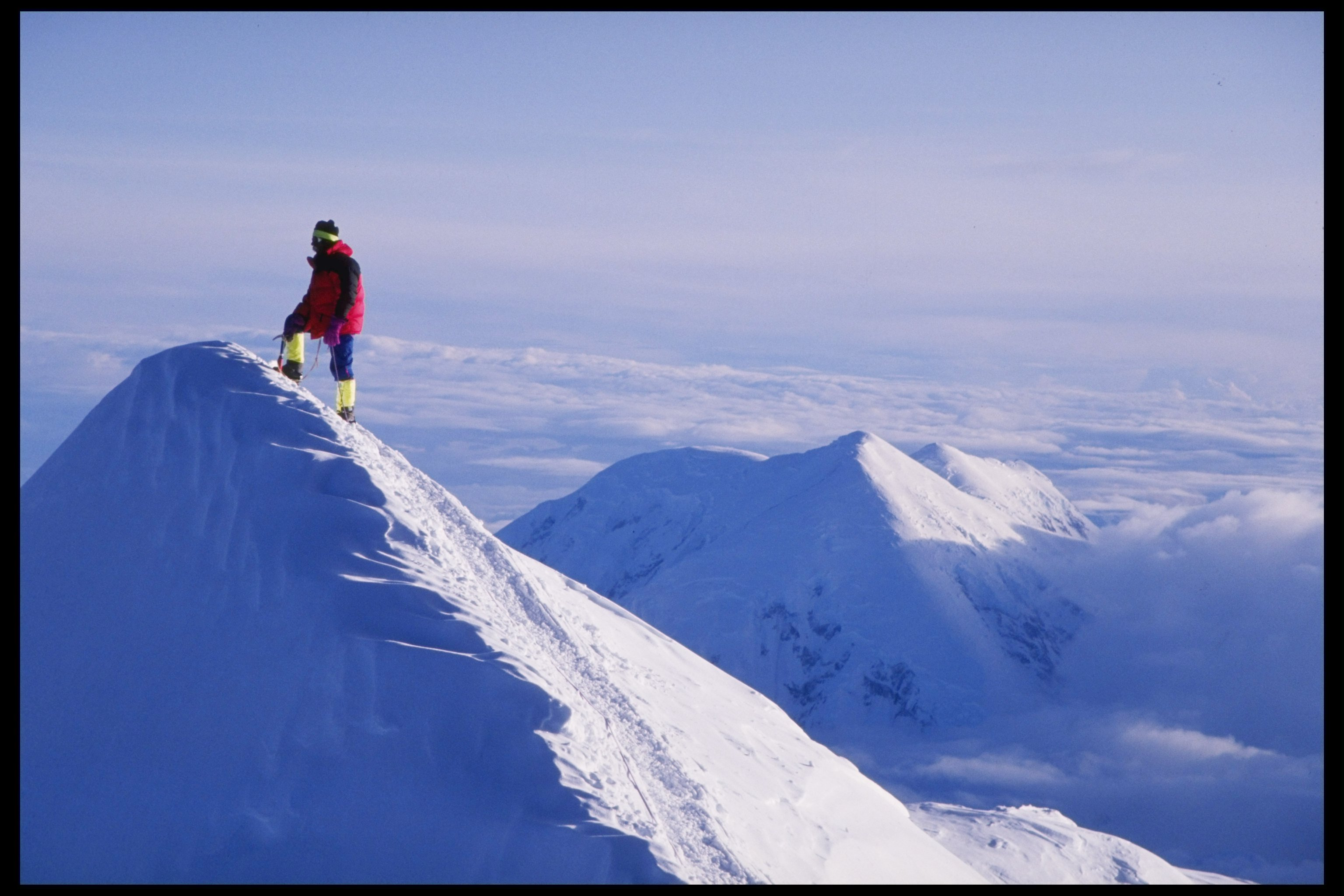 A lone climber stands on the Summit Ridge at Denali. (Getty)