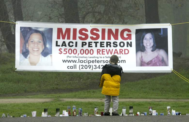 MODESTO, CA - JANUARY 4:  A young child stops to look at a makeshift memorial and a missing person's banner offering a half-million dollar reward for the safe return of Laci Peterson at the East La Loma Park January 4, 2003 in Modesto, California. Peterson, who is eight-months pregnant, has been missing since December 24, 2002 when she allegedly took her dog for a walk in the park while her husband was on a fishing trip.  (Photo by Justin Sullivan/Getty Images)