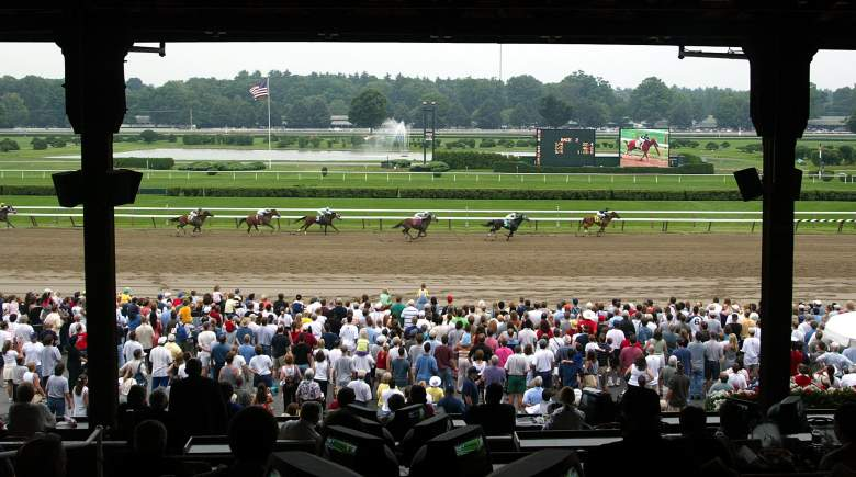 """SARATOGA SPRINGS, NEW YORK - JULY 27: Thoroughbreds race at Saratoga Race Course during opening weekend of the thoroughbred racing season July 27, 2003 in Saratoga Springs, New York. The horse racing industry is hoping that the release of the new movie """"Seabiscuit"""" will revive interest in the nation's struggling racetracks. (Photo by Mario Tama/Getty Images)"""
