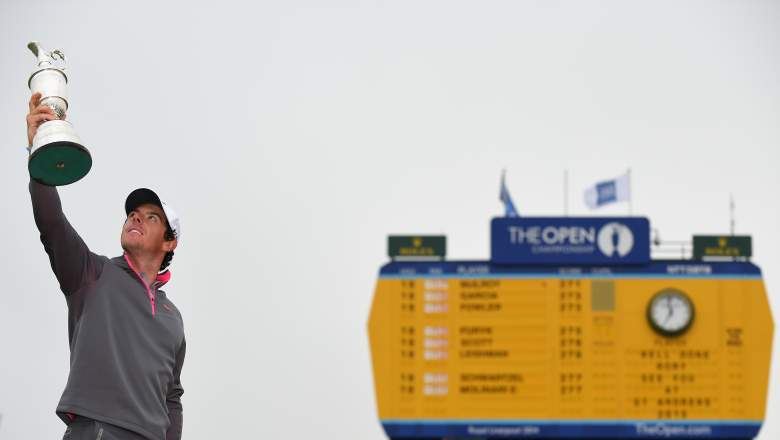 Rory McIlroy lifts the Claret Jug to the sky after his win at the 2014 Open Championship. (Getty)