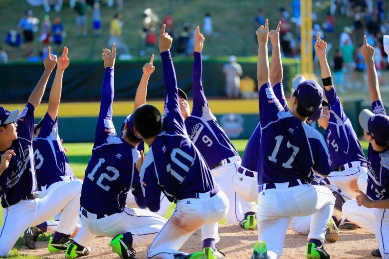 SOUTH WILLIAMSPORT, PA - AUGUST 24: Members of Team Asia-Pacific (L) celebrate following their 8-4 win over the Great Lakes Team from Chicago, Illinois to win the Little League World Series Championship game at Lamade Stadium on August 24, 2014 in South Williamsport, Pennsylvania. (Photo by Rob Carr/Getty Images)
