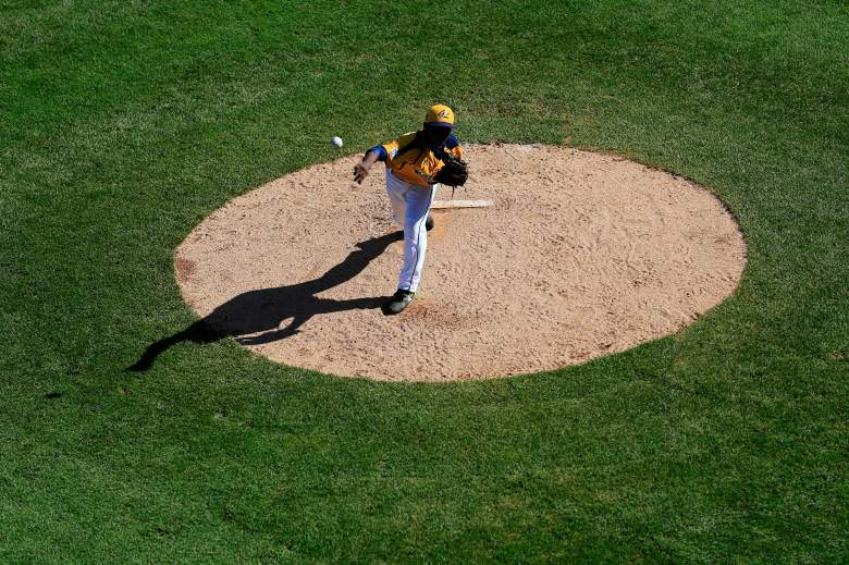 SOUTH WILLIAMSPORT, PA - AUGUST 24: Starting pitcher Brandon Green #14 of the Great Lakes Team from Chicago, Illinois pitches to a batter from Team Asia-Pacific during fourth inning of the Little League World Series Championship game at Lamade Stadium on August 24, 2014 in South Williamsport, Pennsylvania. (Photo by Rob Carr/Getty Images)
