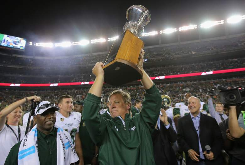 DENVER, CO - AUGUST 29: Head coach Jim McElwain of the Colorado State Rams hoists the Centennial Cup after defeating the the Colorado Buffaloes 31-17 in the Rocky Mountain Showdown at Sports Authority Field at Mile High on August 29, 2014 in Denver, Colorado. (Photo by Doug Pensinger/Getty Images)