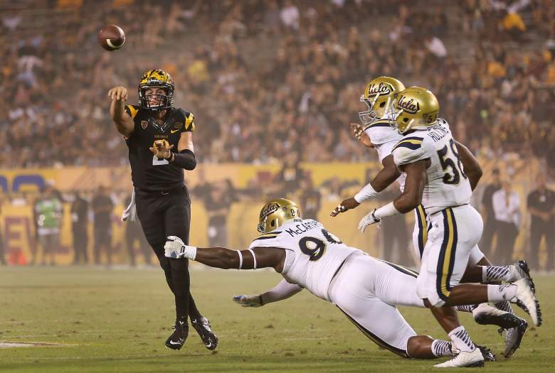 TEMPE, AZ - SEPTEMBER 25: Quarterback Mike Bercovici #2 of the Arizona State Sun Devils throws a pass over defensive lineman Ellis McCarthy #90 of the UCLA Bruins during the fourth quarter of the college football game at Sun Devil Stadium on September 25, 2014 in Tempe, Arizona. The Bruins defeated the Sun Devils 62-27. (Photo by Christian Petersen/Getty Images)