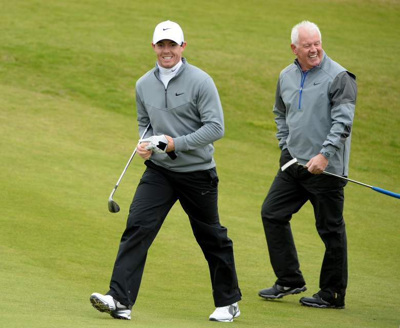 KINGSBARNS, SCOTLAND - OCTOBER 03: Rory McIlroy of Northern Ireland with his playing partner and father Gerry McIlroy on the 10th hole during the second round of the 2014 Alfred Dunhill Links Championship at the Kingsbarns Golf Links on October 3, 2014 in Kingsbarns, Scotland. (Photo by Ross Kinnaird/Getty Images)