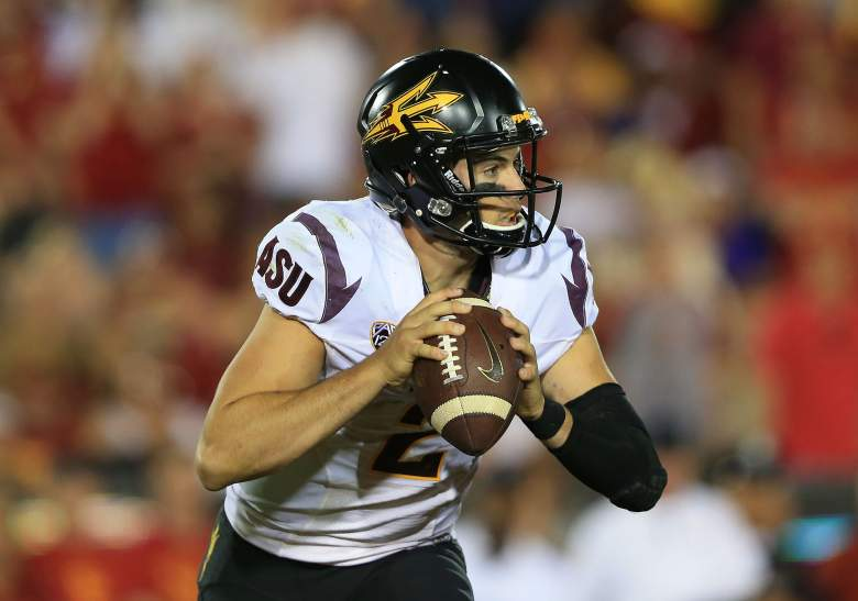 LOS ANGELES, CA - OCTOBER 04: Quarterback Mike Bercovici #2 of the Arizona State Sun Devils scrambles and looks to make a pass play late in the fourth quarter against the USC Trojans in their game at Los Angeles Memorial Coliseum on October 4, 2014 in Los Angeles, California. The Sun Devils defeated the Trojans 38-34. (Photo by Victor Decolongon/Getty Images)