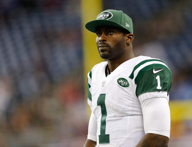 DETROIT, MI - NOVEMBER 24: Michael Vick #1 of the New York Jets looks on after their loss of 3-38 to the Buffalo Bills at Ford Field on November 24 , 2014 in Detroit, Michigan. (Photo by Leon Halip/Getty Images)