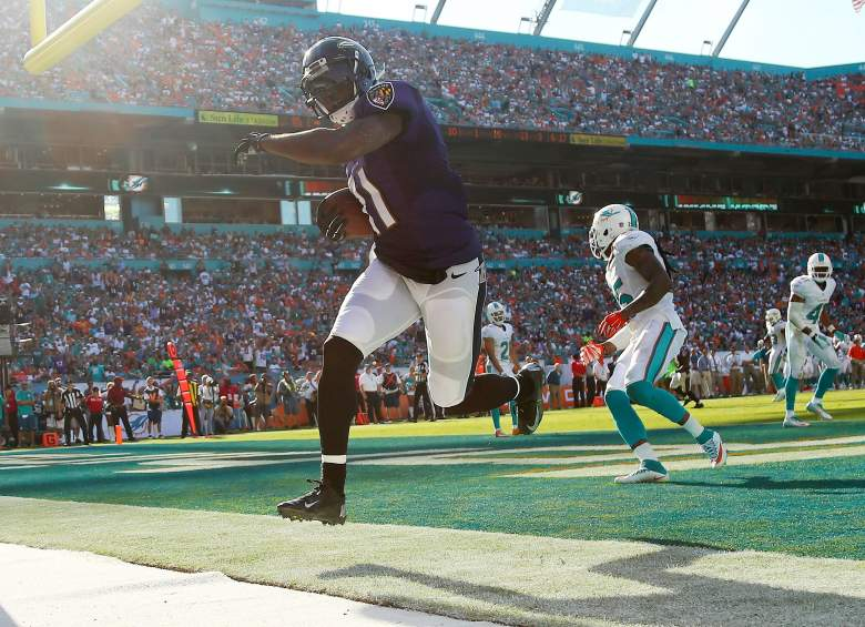 MIAMI GARDENS, FL - DECEMBER 07:  Wide receiver Kamar Aiken #11 of the Baltimore Ravens runs in the endzone as he scores a third quarter touchdown as free safety Louis Delmas #25 of the Miami Dolphins trails during a game at Sun Life Stadium on December 7, 2014 in Miami Gardens, Florida.  (Photo by Mike Ehrmann/Getty Images)
