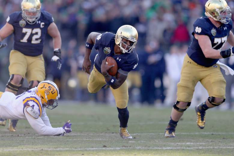 NASHVILLE, TN - DECEMBER 30: Malik Zaire #8 of the Notre Dame Fighting Irish runs with the ball against the LSU Tigers during the Franklin American Mortgage Music City Bowl at LP Field on December 30, 2014 in Nashville, Tennessee. (Photo by Andy Lyons/Getty Images)