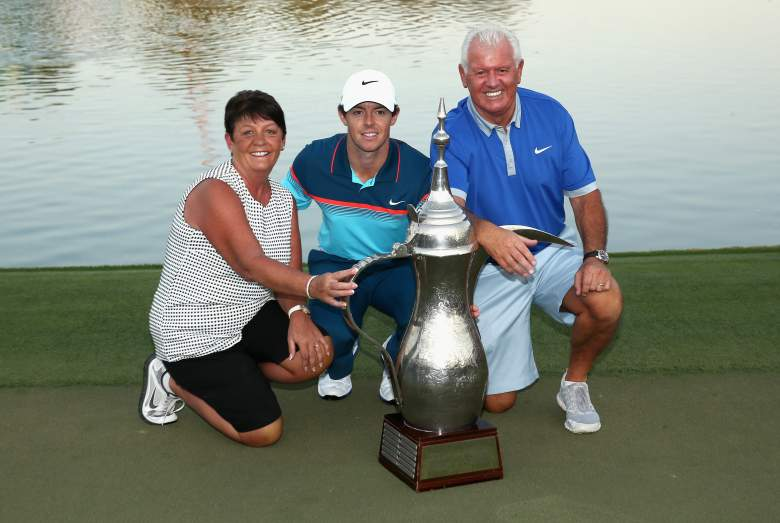 DUBAI, UNITED ARAB EMIRATES - FEBRUARY 01: Rory McIlroy of Northern Ireland poses with his parents, Rose and Gerry McIlroy after winning the Omega Dubai Desert Classic on the Majlis Course at the Emirates Golf Club on February 1, 2015 in Dubai, United Arab Emirates. (Photo by Warren Little/Getty Images)