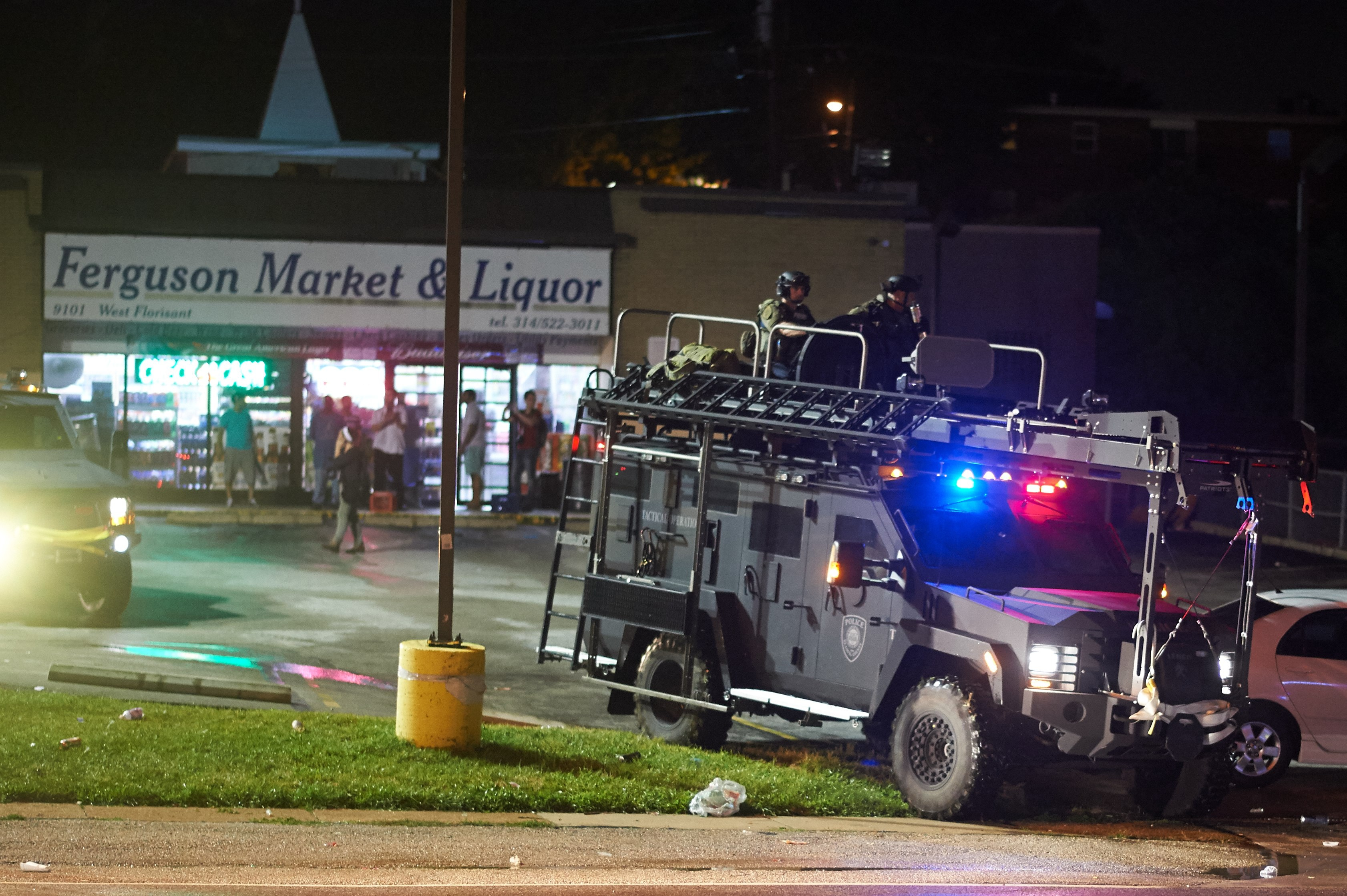 Police officers in a MRAP outside a market in Ferguson. (Getty)