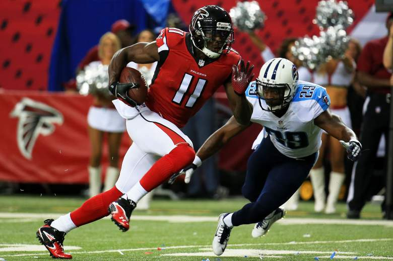 ATLANTA, GA - AUGUST 14: Julio Jones #11 of the Atlanta Falcons runs past Perrish Cox #29 of the Tennessee Titans on route for a touchdown in the first half of a preseason game at the Georgia Dome on August 14, 2015 in Atlanta, Georgia. (Photo by Daniel Shirey/Getty Images)