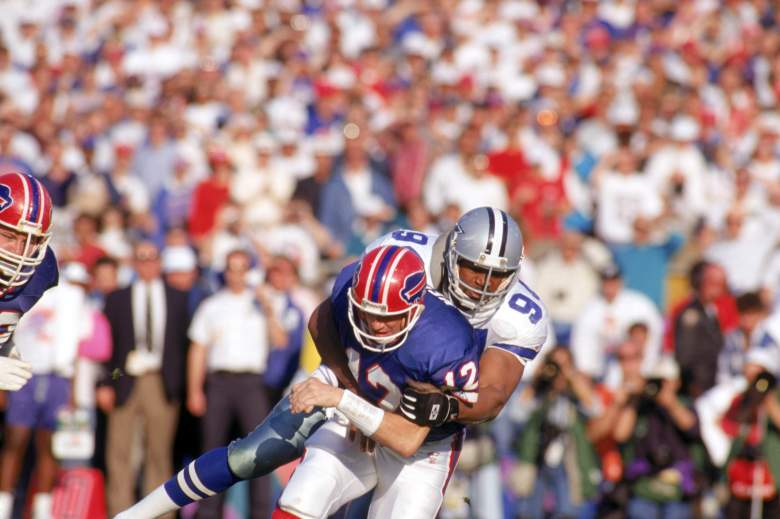 PASADENA, CA - JANUARY 31:  Defensive end Charles Haley #94 of the Dallas Cowboys puts a hit on quarterback Jim Kelly #12 of the Buffalo Bills during Super Bowl XXVII at the Rose Bowl on January 31, 1993 in Pasadena, California.  The Cowboys won 52-17.  (Photo by George Rose/Getty Images)