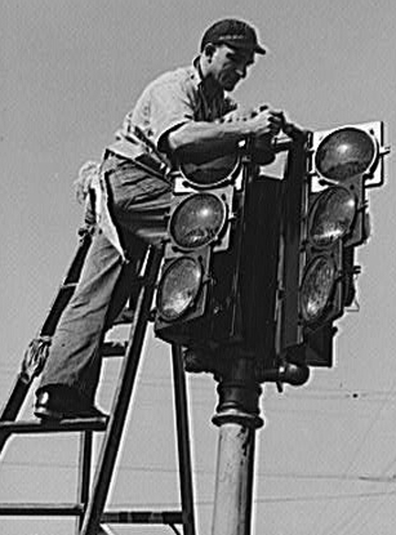 The installation of a traffic light in San Diego in December 1940. (Wikipedia)