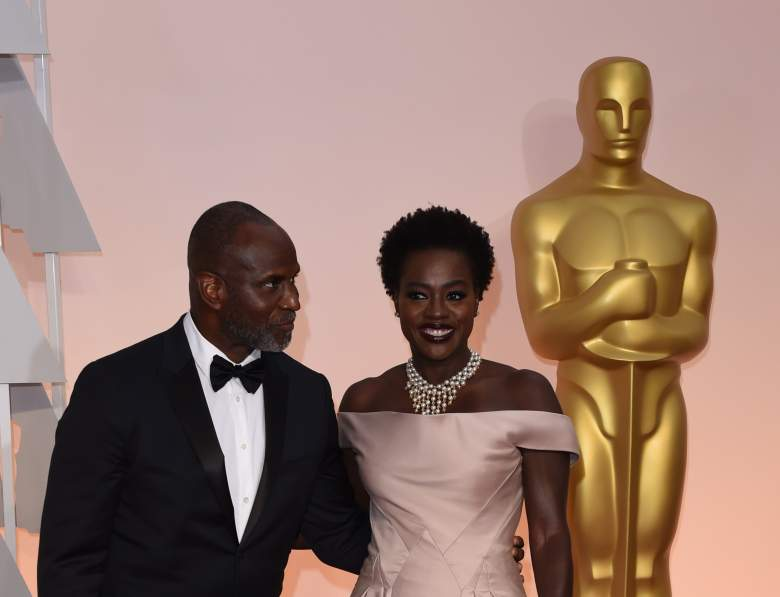 Viola Davis (R) and Julius Tennon  pose on the red carpet for the 87th Oscars on February 22, 2015 in Hollywood, California. AFP PHOTO / MARK RALSTON        (Photo credit should read MARK RALSTON/AFP/Getty Images)