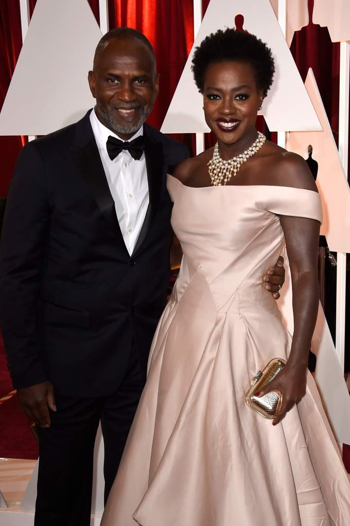 HOLLYWOOD, CA - FEBRUARY 22:  Actress Viola Davis (R) and Julius Tennon attend the 87th Annual Academy Awards at Hollywood & Highland Center on February 22, 2015 in Hollywood, California.  (Photo by Frazer Harrison/Getty Images)