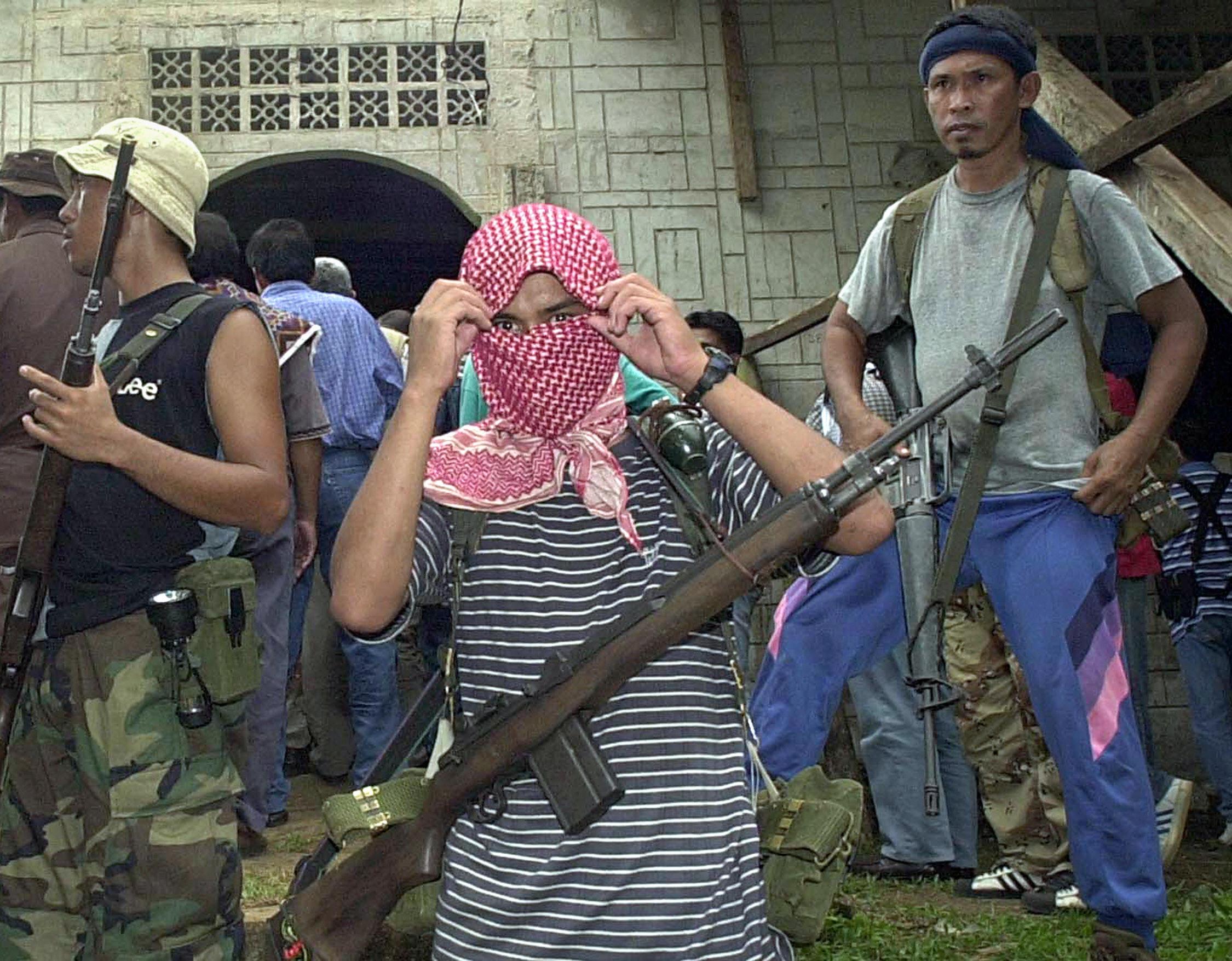 A May 2000 file picture shows Al-Qaeda linked Abu Sayyaf gunmen guard a mosque in Bandang village,  (Getty)