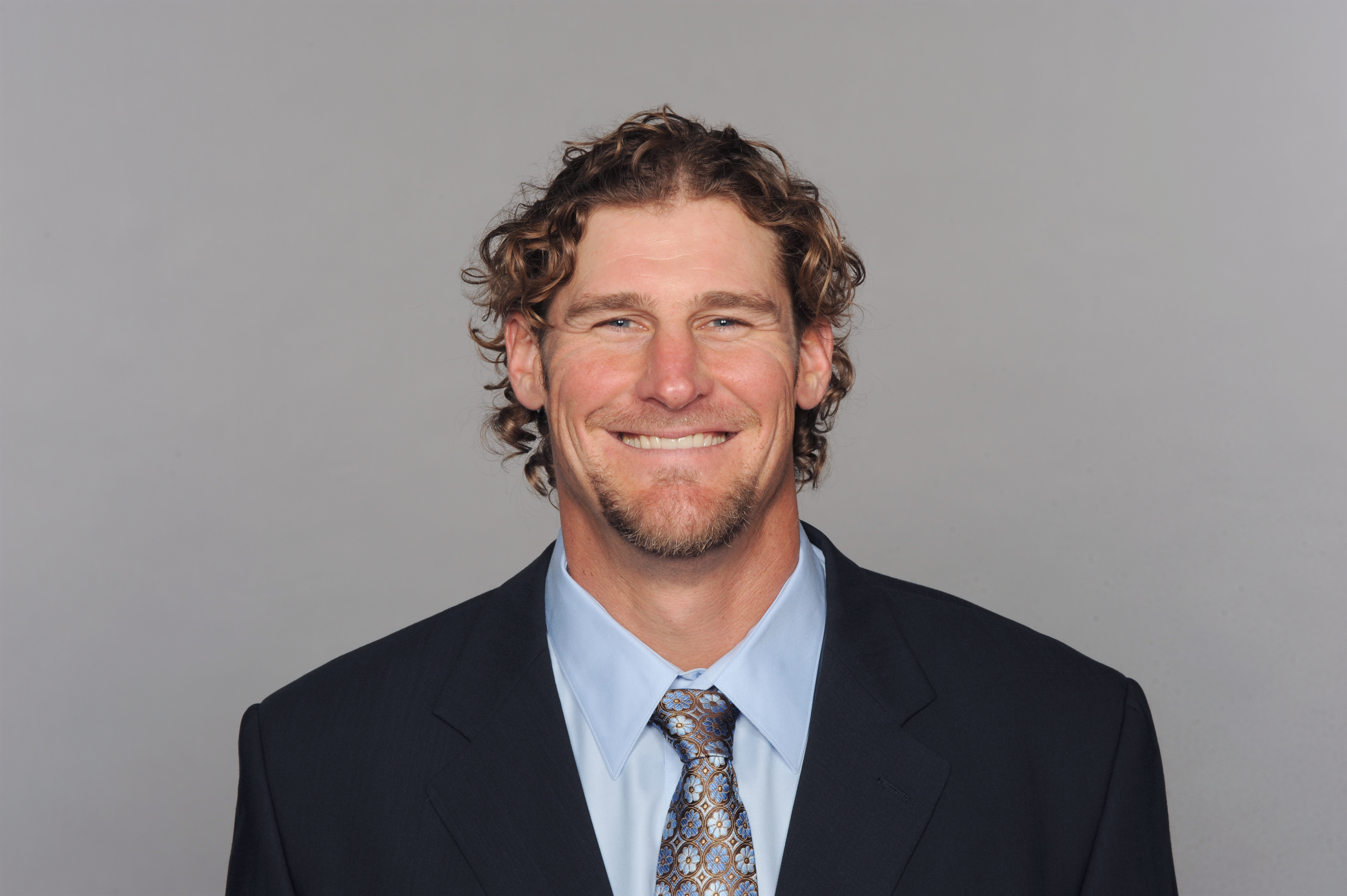 The hair is now gone, but the smile remains the same: Dan Campbell is the new Dolphins coach. (Getty)