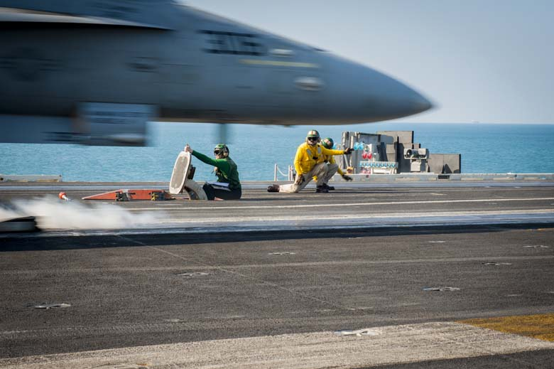 An F/A-18C Hornet from the Stingers of Strike Fighter Squadron (VFA) 113 launches in November 2014 in support of the operation against ISIS. (Getty)