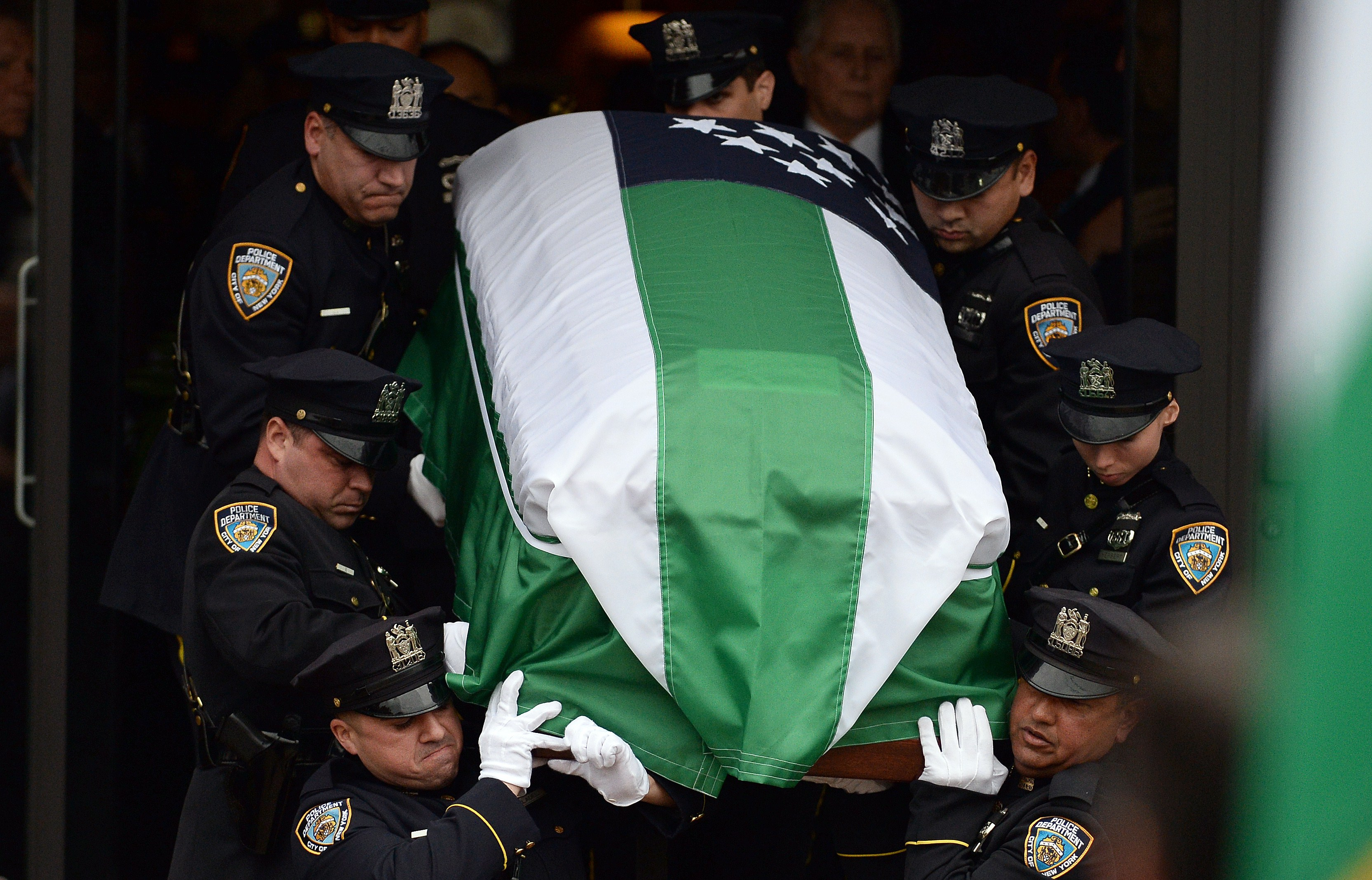 New York Police Department officers carry the casket of their fellow officer Wenjian Liu during his funeral in New York's borough of Brooklyn on January 4, 2015. (Getty)