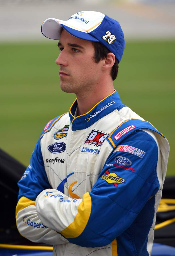 JOLIET, IL - SEPTEMBER 18: Austin Theriault, driver of the #29 Cooper Standard Ford, stands on the grid during qualifying for the NASCAR Camping World Truck Series American Ethanol E15 225 at Chicagoland Speedway on September 18, 2015 in Joliet, Illinois. (Photo by Josh Hedges/Getty Images)