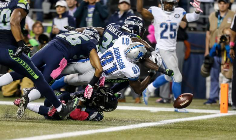 Seattle's Kam Chancellor knocks the ball loose from Detroit's Calvin Johnson during Week 4. (Getty)