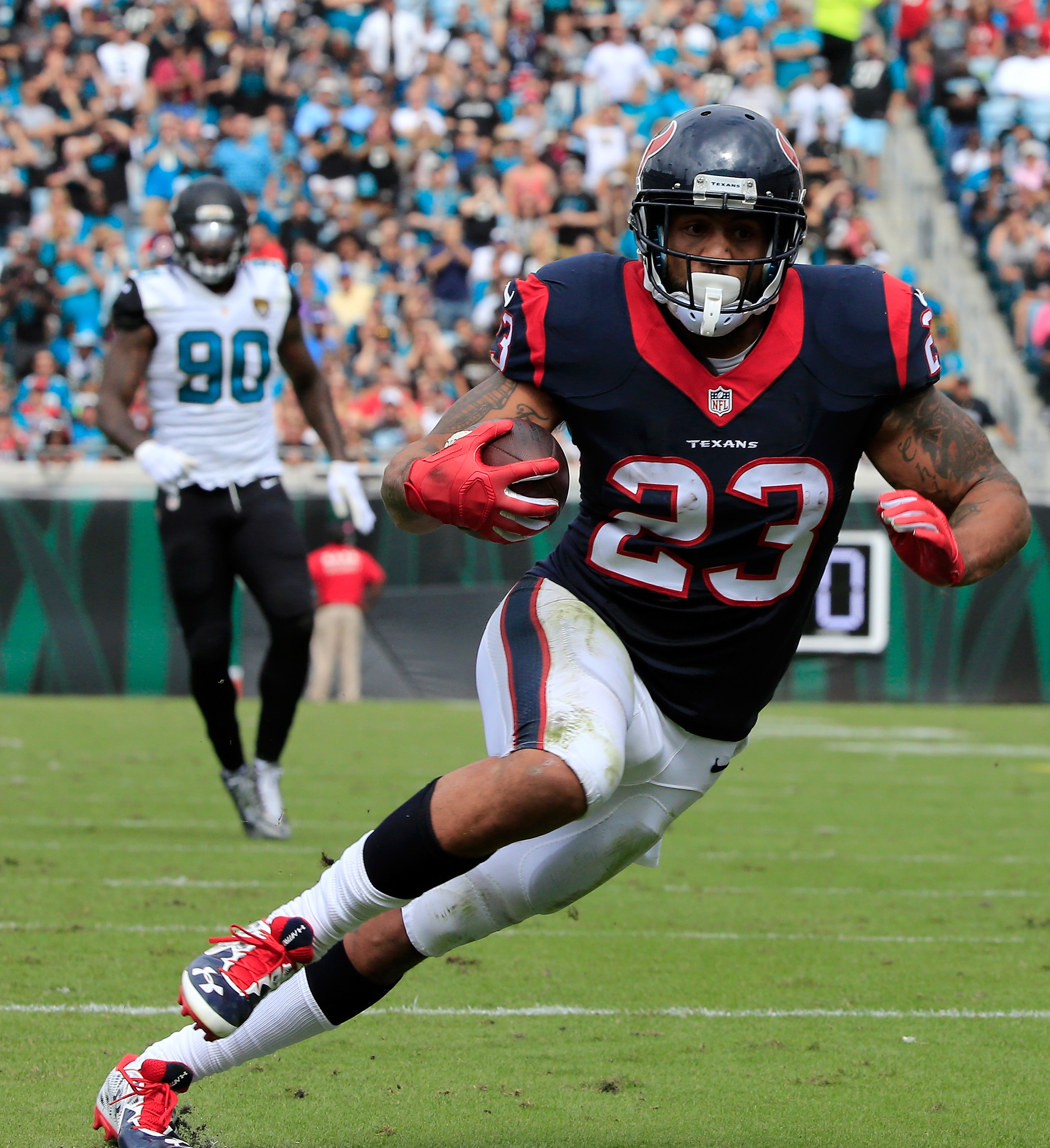 Arian Foster has the game's only touchdown at halftime. (Getty)