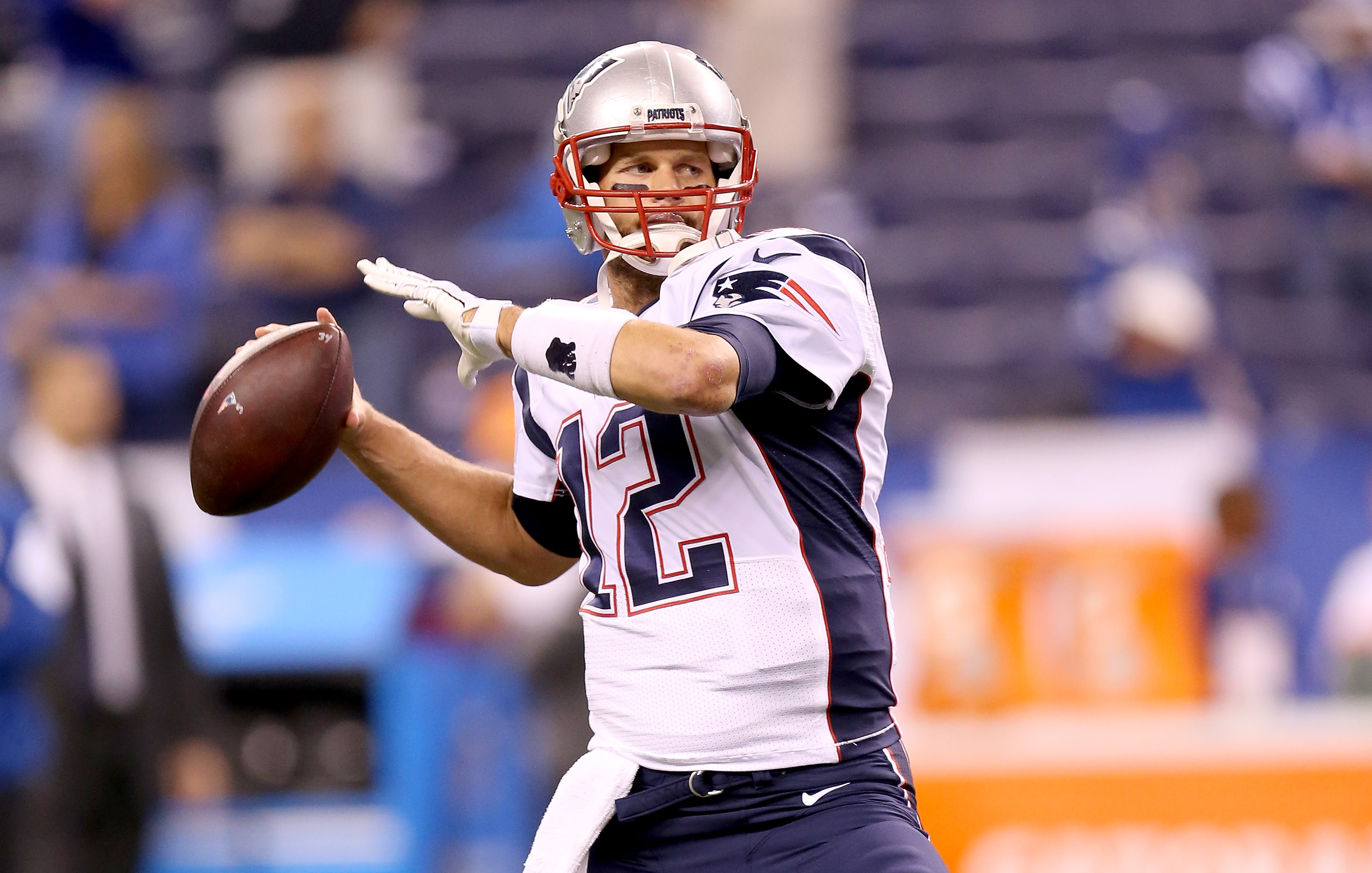 Tom Brady's first INT of the night was returned for a TD. (Getty)