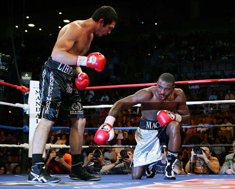 LAS VEGAS - OCTOBER 06:  Librado Andrade (L) knocks Yusaf Mack to the canvas in the seventh round of their super middlewight fight to win by TKO at the Mandalay Bay Events Center October 6, 2007 in Las Vegas, Nevada.  (Getty)