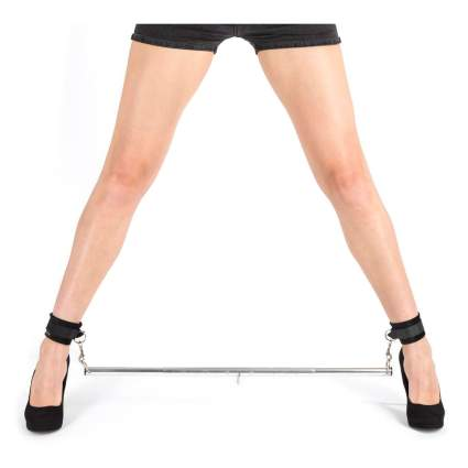 Woman's leg's in spreader bar