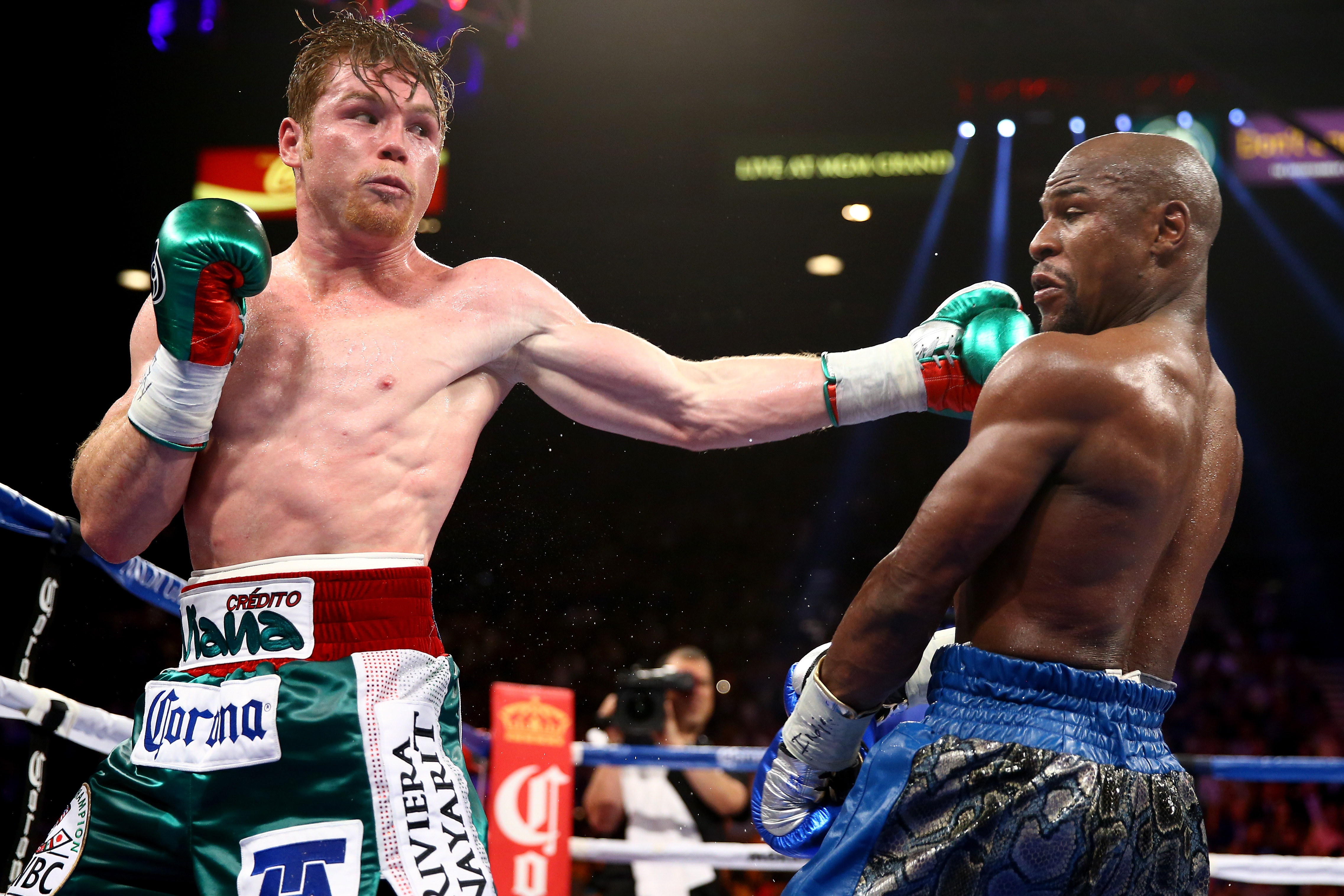 Canelo Alvarez takes a swipe at Floyd Mayweather Jr. during their September 14, 2013 encounter. (Getty)