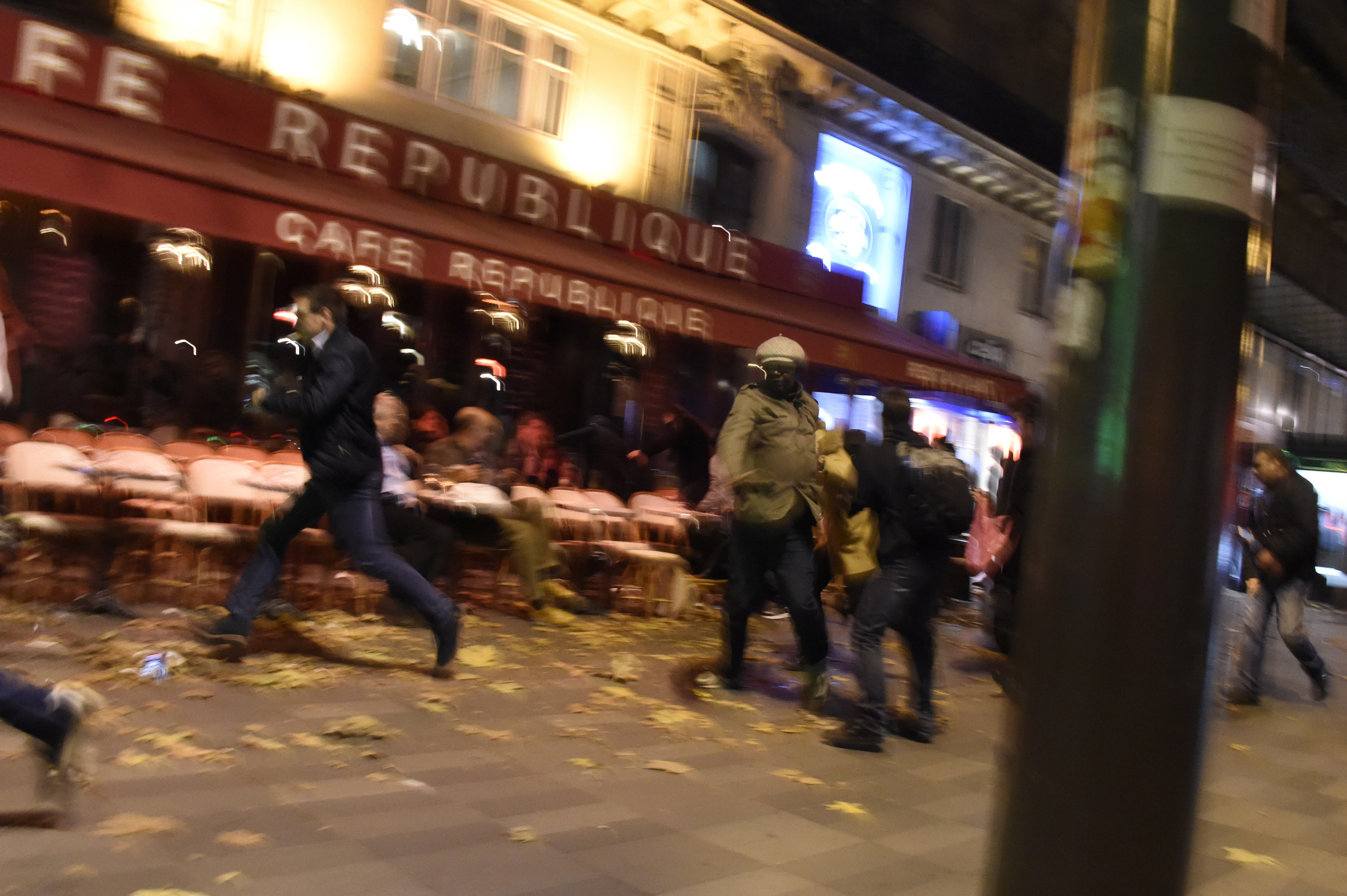 People run after hearing what is believed to be explosions or gun shots near Place de la Republique square. (Getty)