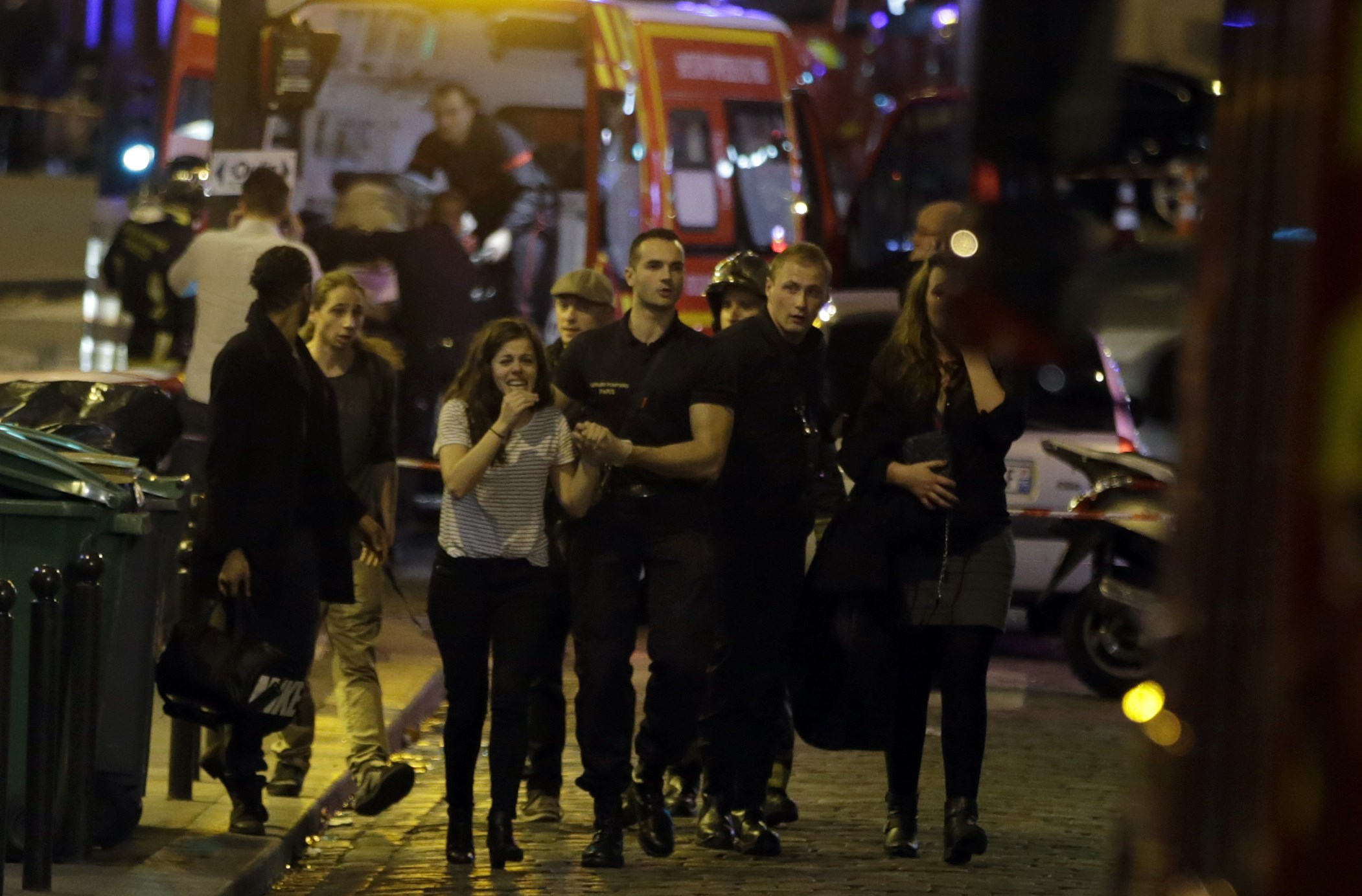 Rescuers evacuate people following an attack in the 10th arrondissement of the French capital Paris. (Getty)