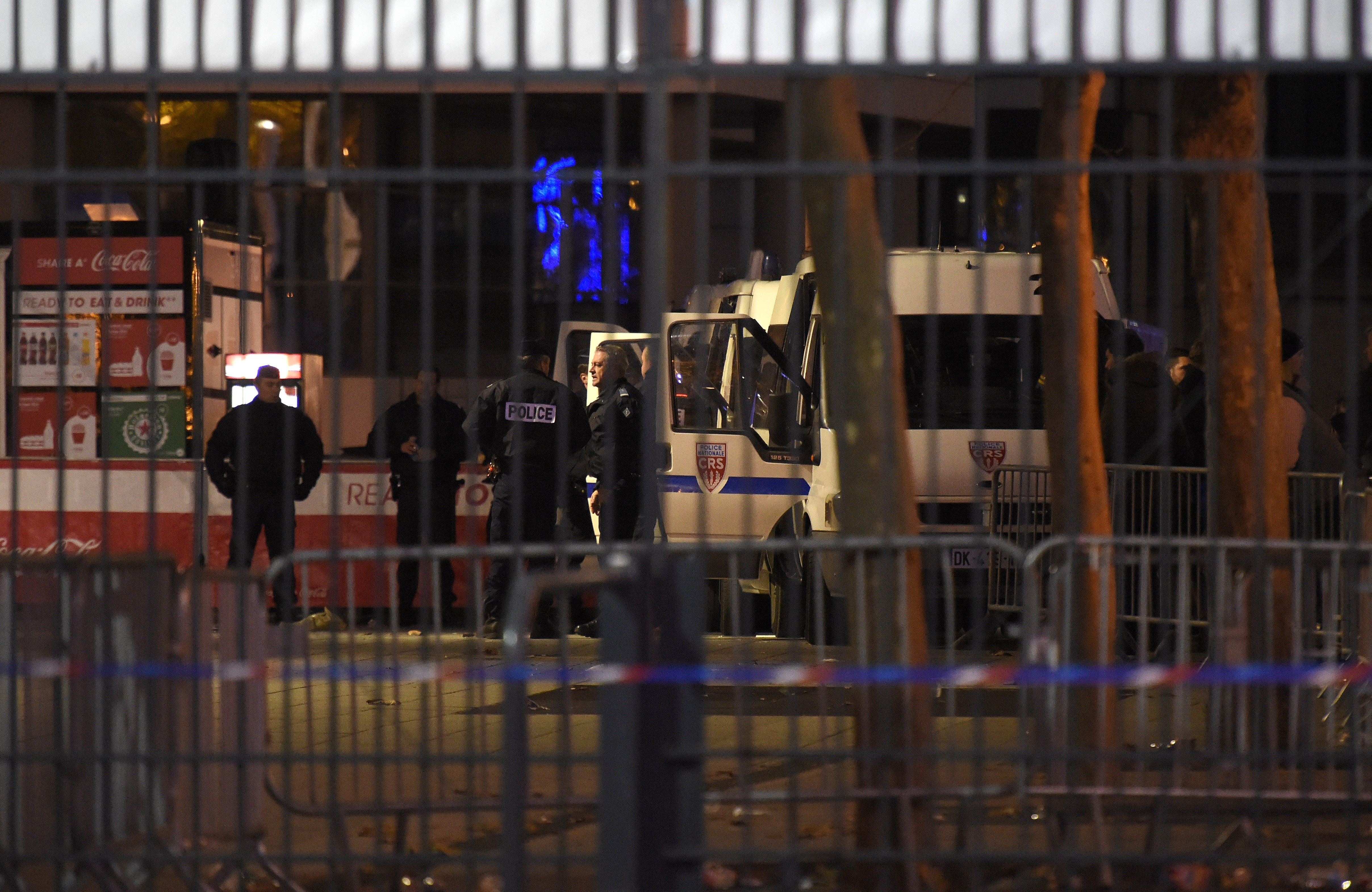Police forces stand guard outside the Stade de France stadium in Saint-Denis, north of Paris after three suicide bombs were detonated. (Getty)