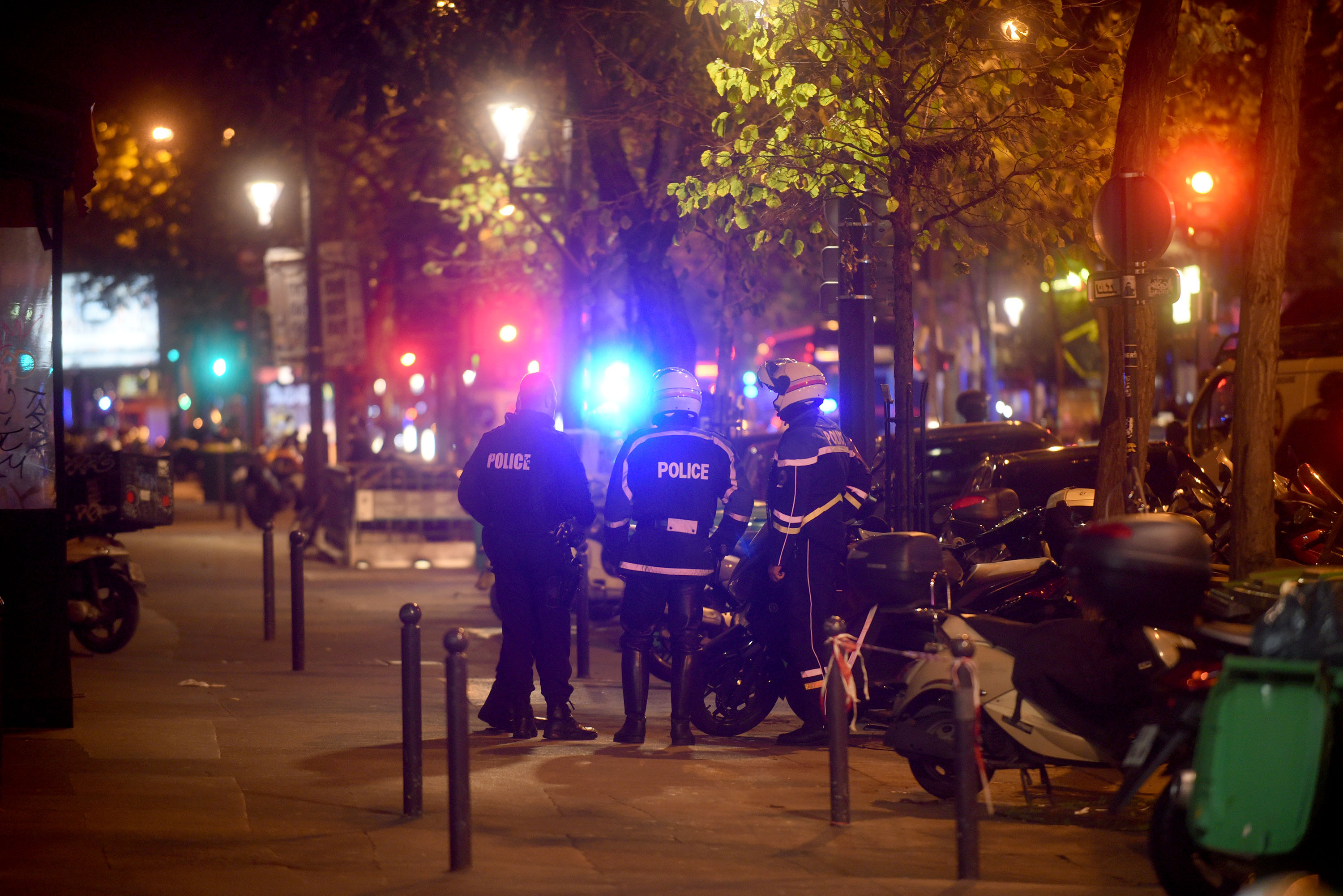 Policemen patrol the streets during gunfire near the Bataclan concert hall. (Getty)