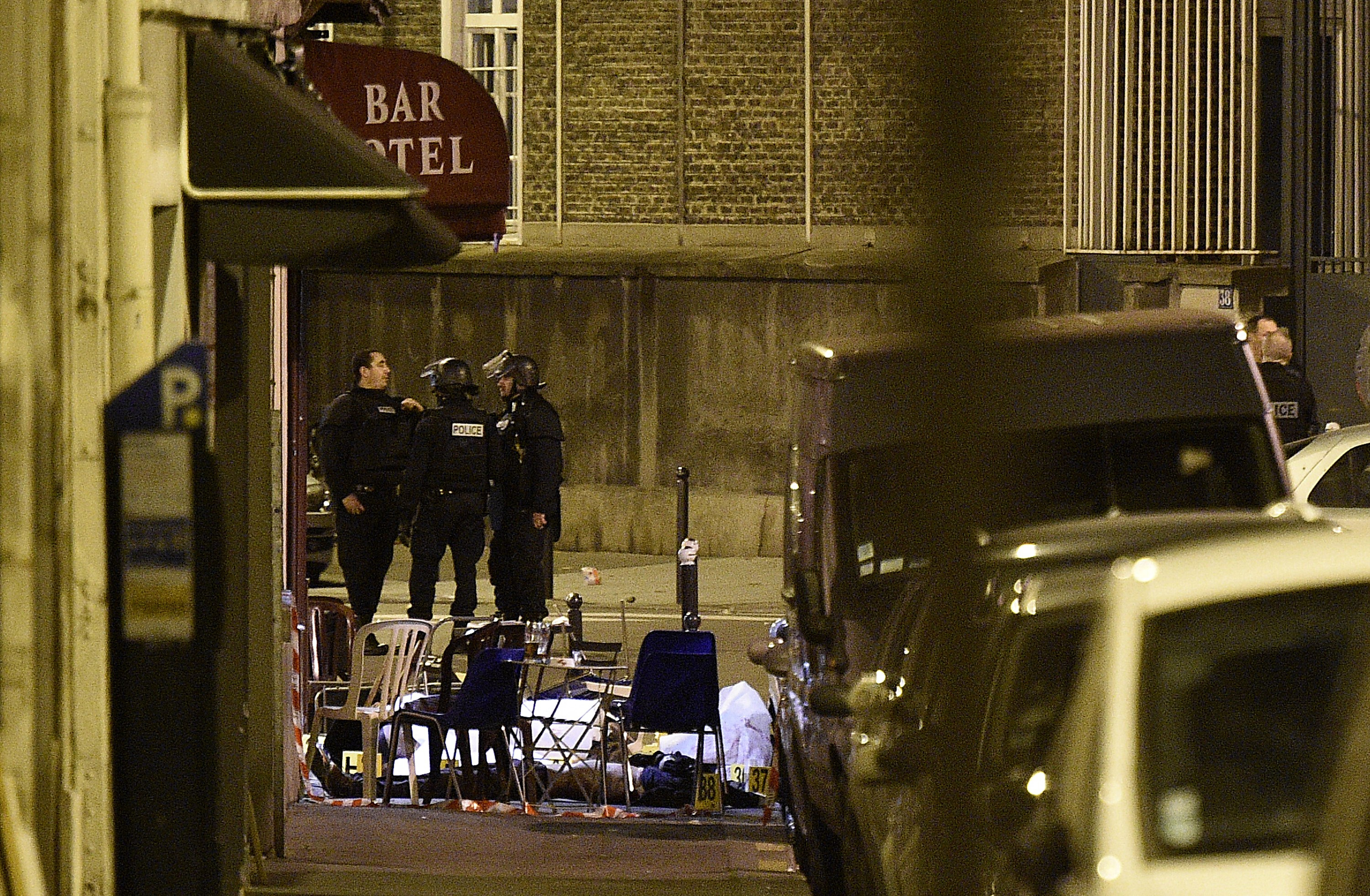 A victim lies on the ground covered by a white sheet following an attack at rue Bichat. (Getty)