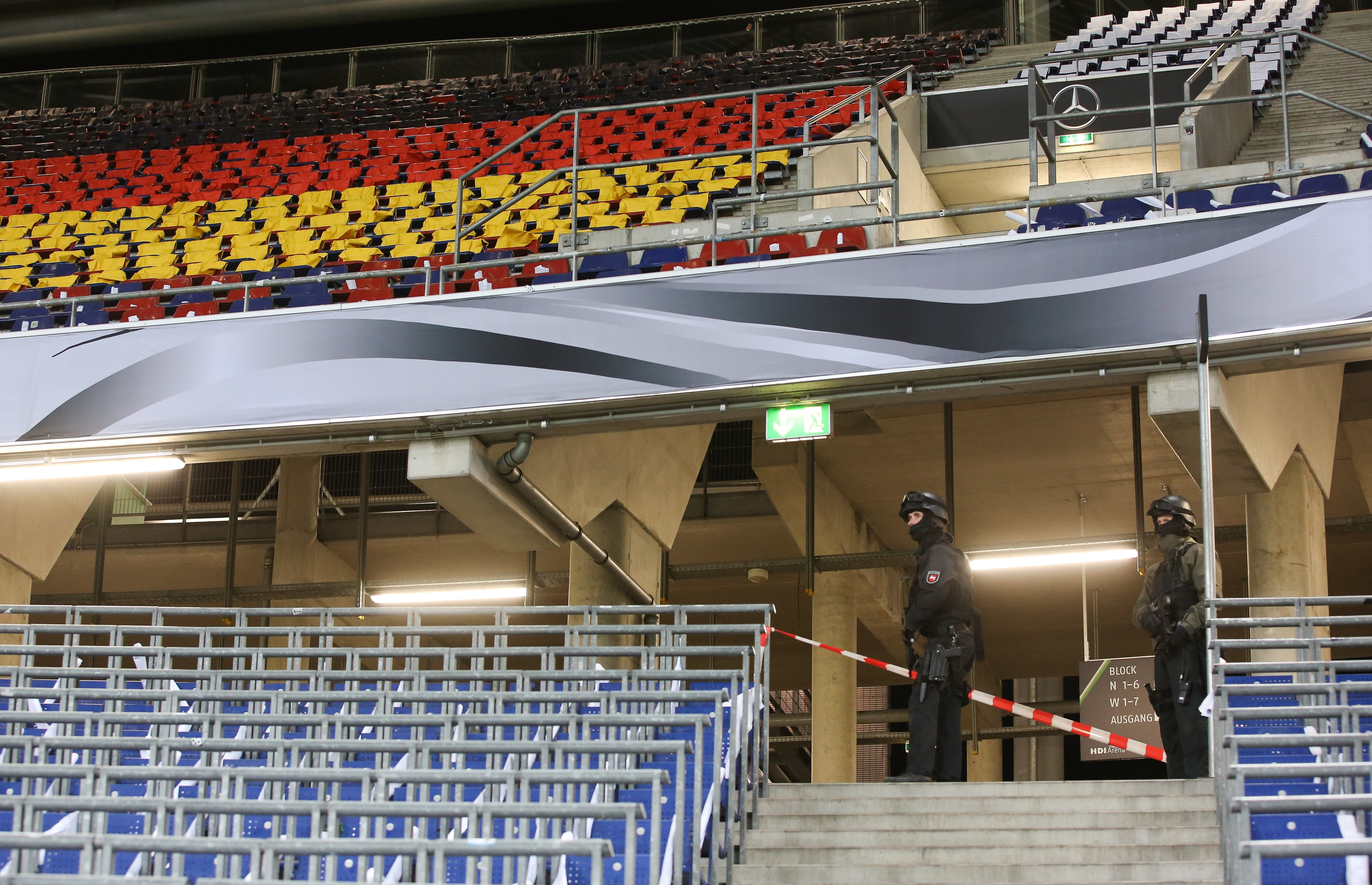 Police check  the stands after the friendly football match was cancelled. (Getty)
