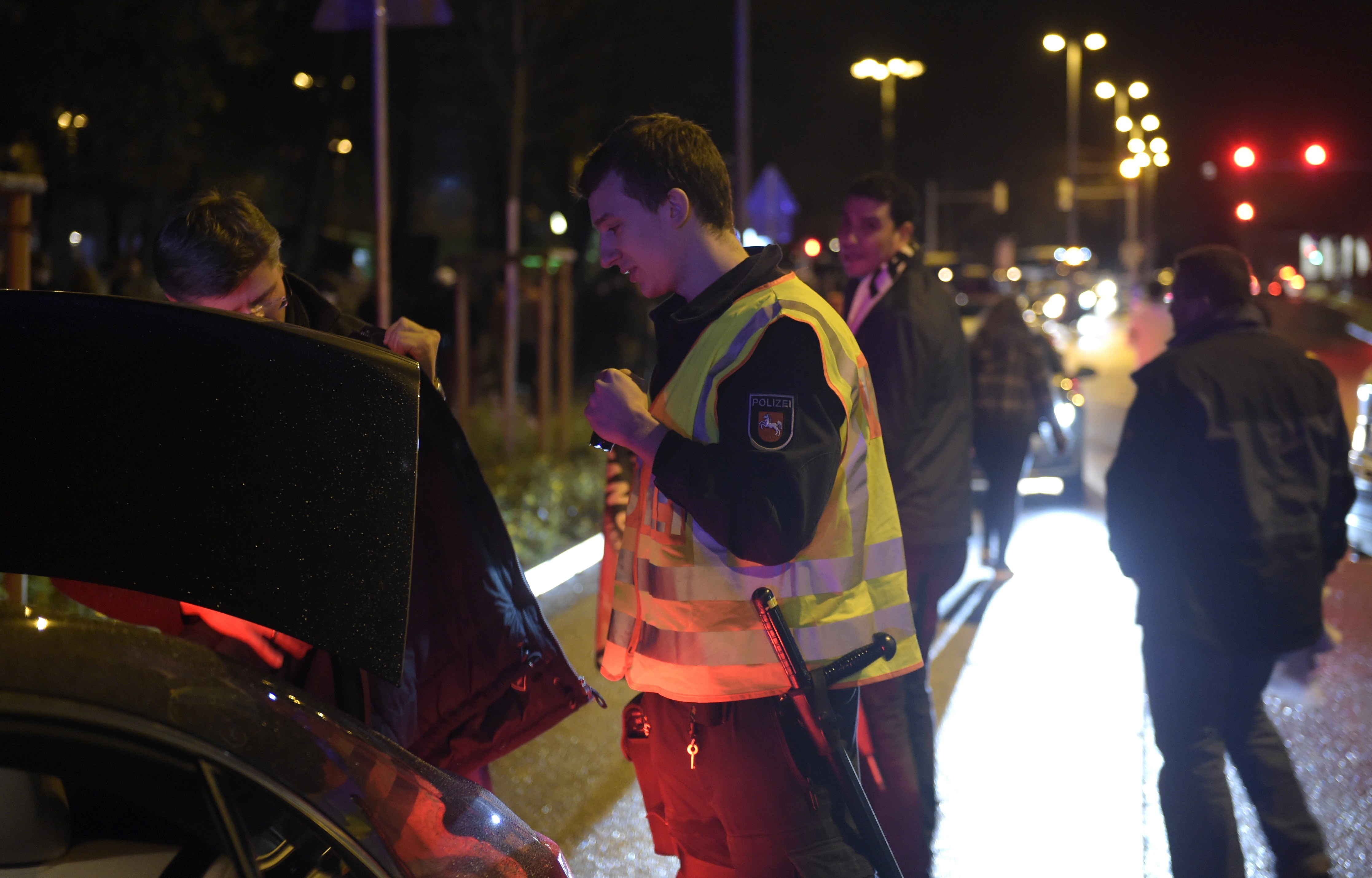 Police checks cars as supporters leave the stadium after the friendly football match was called off for security reasons. (Getty)
