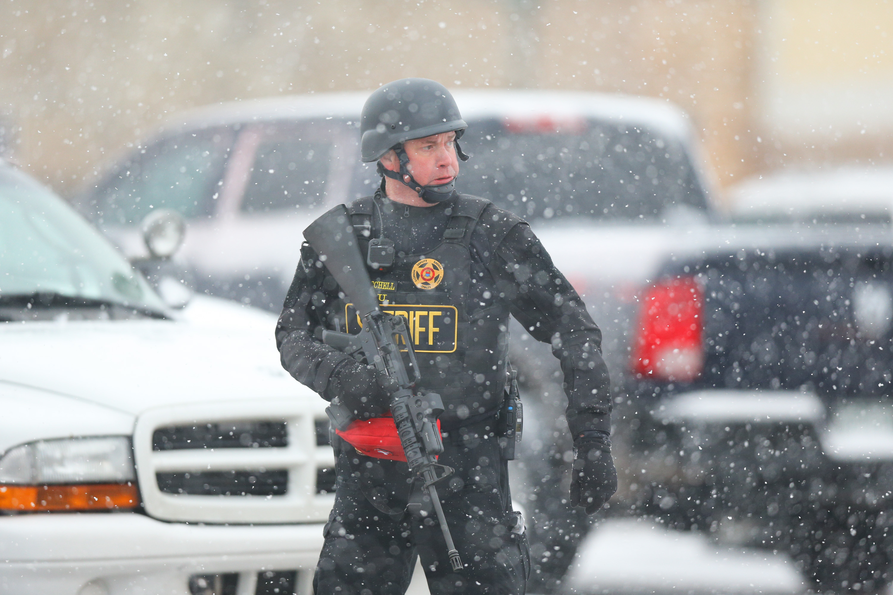 A member of the Colorado Springs sheriff's department secures the scene during an active shooter situation at a Planned Parenthood facility. (Getty)
