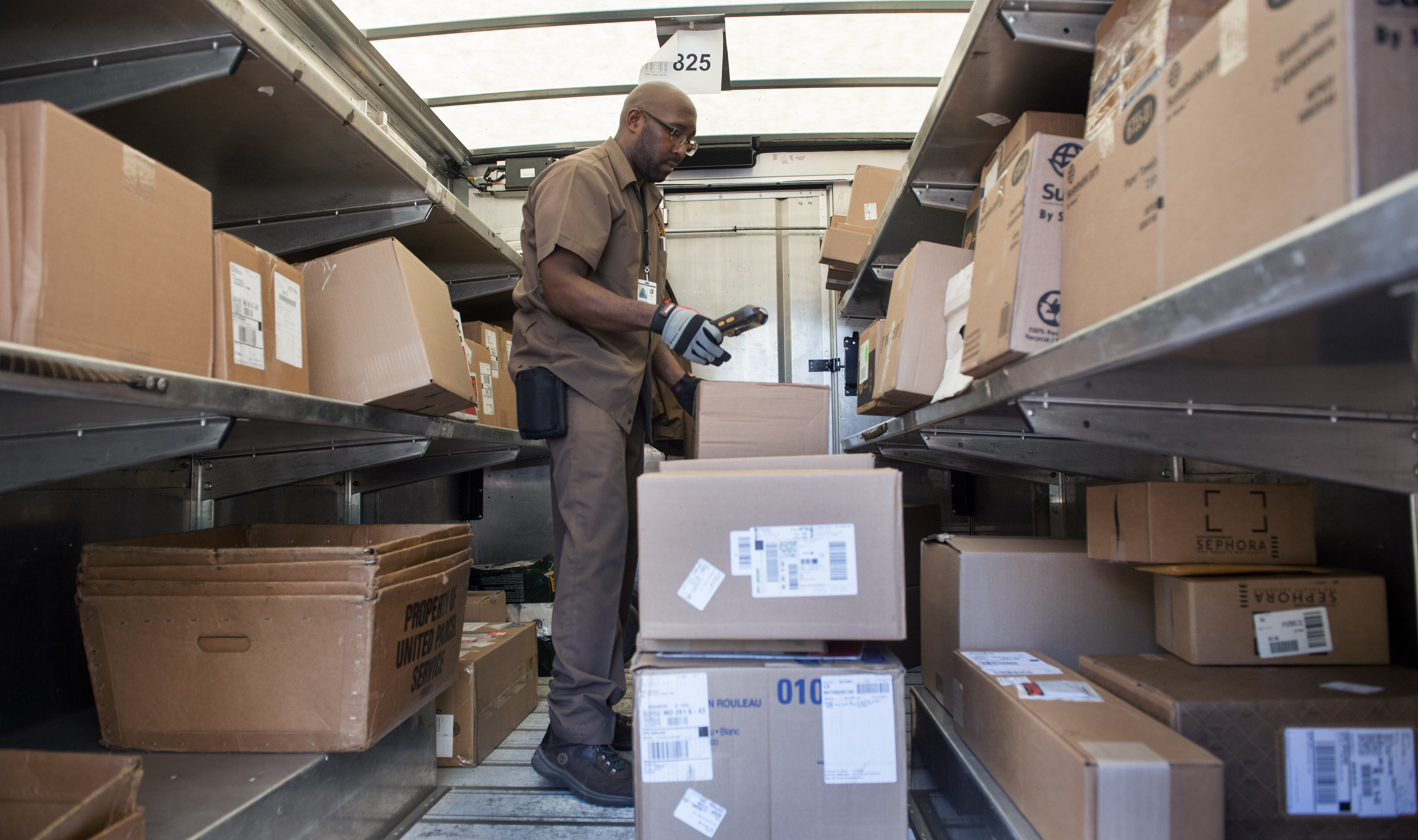 A UPS driver inventories and organizes his packages  in the back of his delivery truck  November 17, 2015, in Washington, DC.  (Getty)