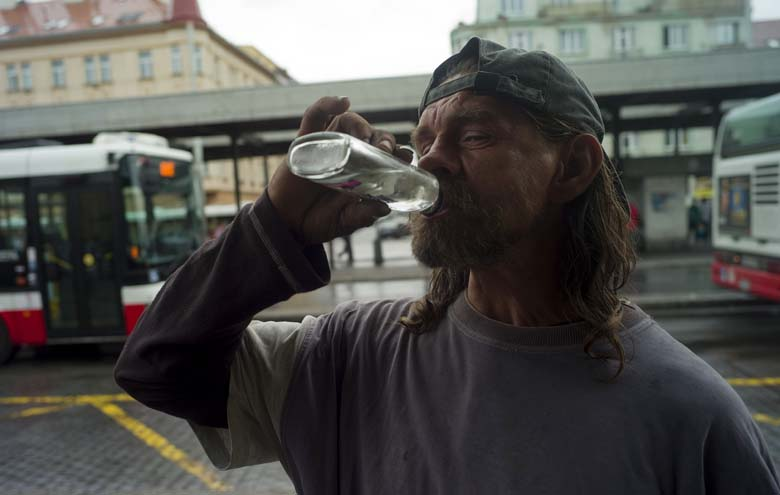 "A man drinks aolcohol from a bottle on a street in Prague on September 12, 2012. At least 14 people  died and more than 20 were hospitalised in the Czech Republic that year after drinking spirits apparently tainted with methanol, Czech officials said. ""The last figure I've heard was 14, but the numbers... must be taken with caution as it takes two or three days to confirm the cause of death by autopsy,"" Health Minister Leos Heger told reporters.  (Getty)"