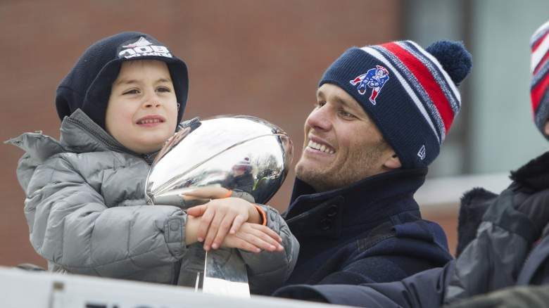 Tom Brady with his youngest son, Benjamin, during the Patriots' Super Bowl parade in 2015. (Getty)