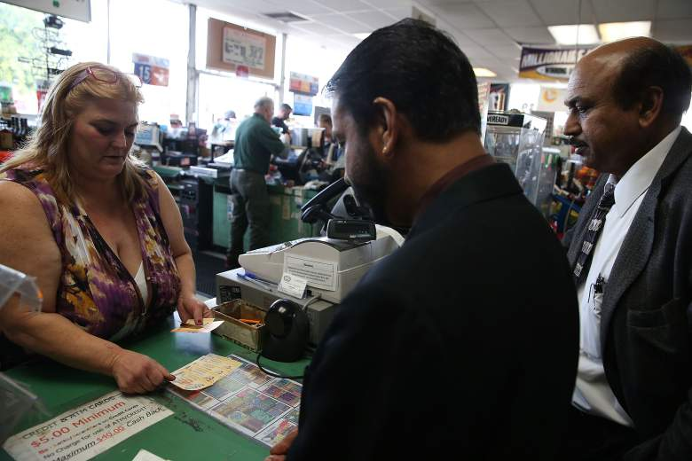 SAN LORENZO, CA - JANUARY 12: Johanna McDaniel (L) sells Powerball tickets at Kavanagh Liquors on January 12, 2015 in San Lorenzo, California. Dozens of people lined up outside of Kavanagh Liquors, a store that has had several multi-million dollar winners, to -purchase Powerball tickets in hopes of winning the estimated record-breaking $1.5 billion dollar jackpot. (Photo by Justin Sullivan/Getty Images)