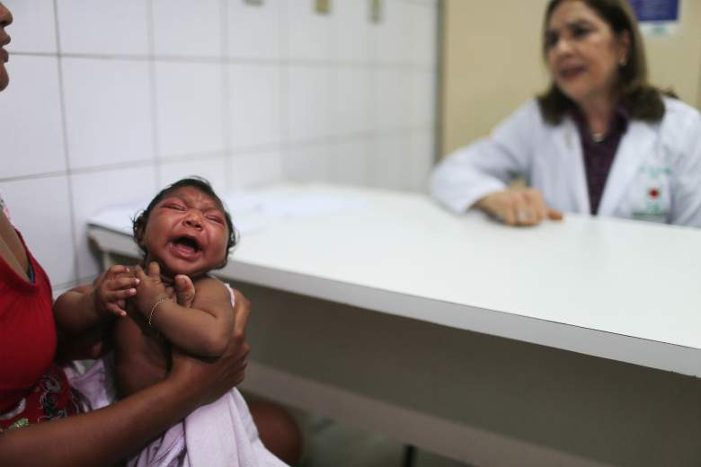 RECIFE, BRAZIL - JANUARY 26:  Dr. Angela Rocha (R), pediatric infectologist at Oswaldo Cruz Hospital, speaks during an examination of Ludmilla Hadassa Dias de Vasconcelos (2 months), who has microcephaly, on January 26, 2016 in Recife, Brazil. In the last four months, authorities have recorded close to 4,000 cases in Brazil in which the mosquito-borne Zika virus may have led to microcephaly in infants. The ailment results in an abnormally small head in newborns and is associated with various disorders including decreased brain development. According to the World Health Organization (WHO), the Zika virus outbreak is likely to spread throughout nearly all the Americas. At least twelve cases in the United States have now been confirmed by the CDC. Brazil reported the first cases in the Americas of local transmissions of the virus last year.  (Photo by Mario Tama/Getty Images)