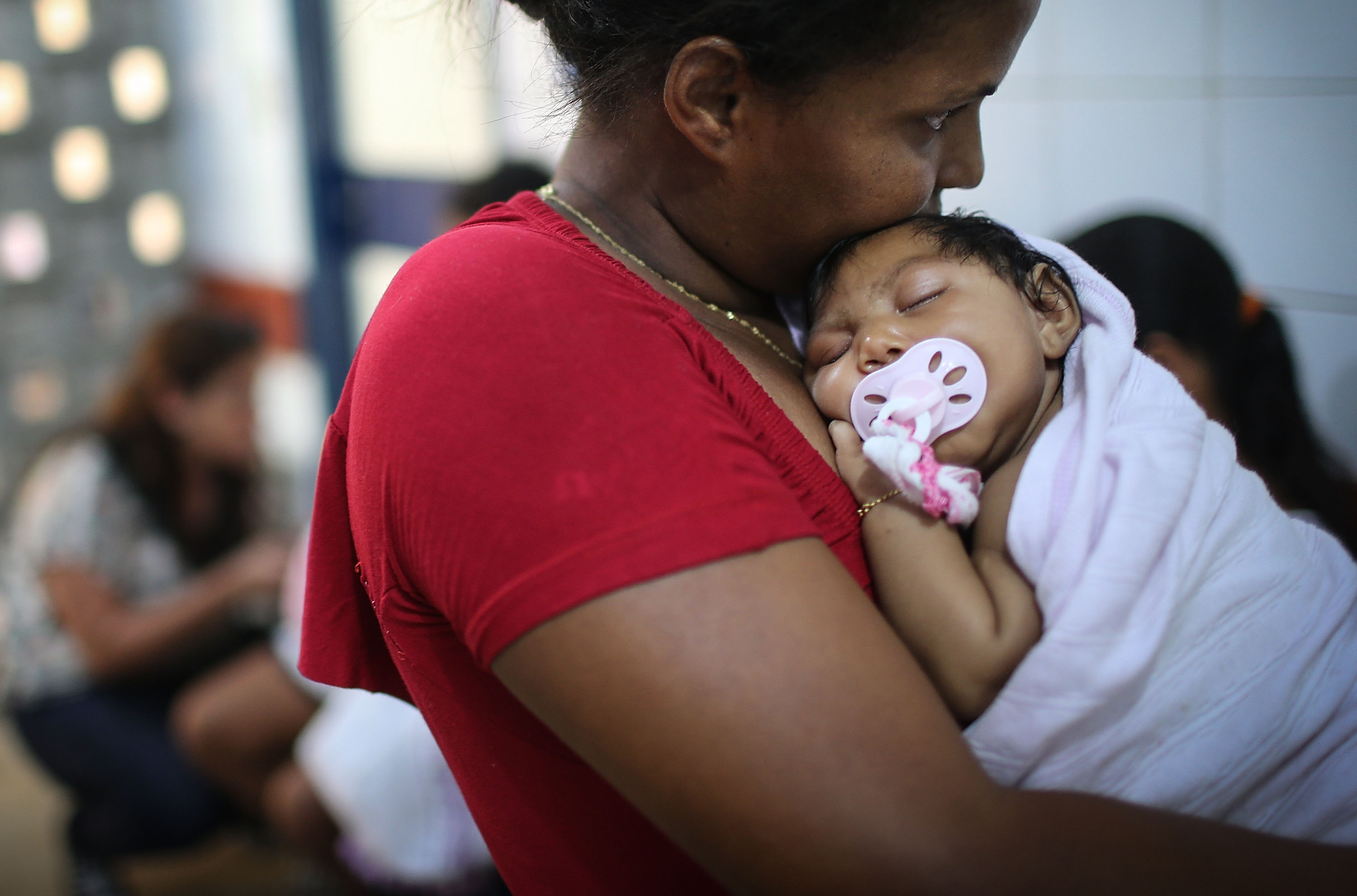 Grandmother Ivalda Caetano holds 2-month-old Ludmilla Hadassa Dias de Vasconcelos, who has microcephaly, at Oswald Cruz hospital on January 26, 2016 in Recife, Brazil. In the last four months, authorities have recorded close to 4,000 cases in Brazil in which the mosquito-borne Zika virus may have led to microcephaly in infants. The ailment results in an abnormally small head in newborns and is associated with various disorders including decreased brain development. (Getty)