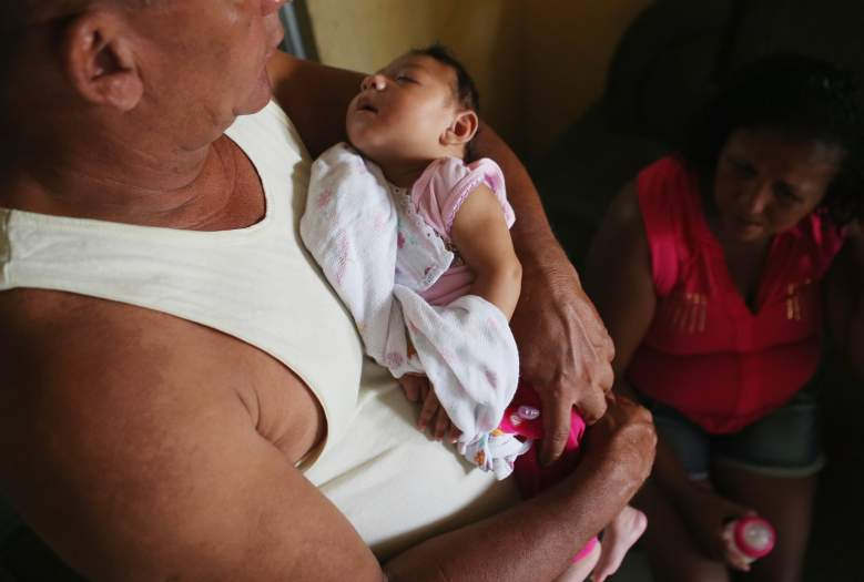 RECIFE, BRAZIL - JANUARY 27:  Alice Vitoria Gomes Bezerra, 3-months-old, who has microcephaly, is held by her father Joao Batista Bezerra (L) as mother Nadja Cristina Gomes Bezerra sits on January 27, 2016 in Recife, Brazil. In the last four months, authorities have recorded close to 4,000 cases in Brazil in which the mosquito-borne Zika virus may have led to microcephaly in infants. The ailment results in an abnormally small head in newborns and is associated with various disorders including decreased brain development. According to the World Health Organization (WHO), the Zika virus outbreak is likely to spread throughout nearly all the Americas. At least twelve cases in the United States have now been confirmed by the CDC.  (Photo by Mario Tama/Getty Images)