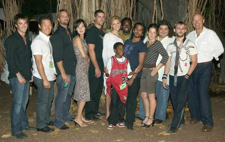 """HONOLULU - AUGUST 28: Cast members of ABC's new TV drama """"Lost"""" pose before a banyan tree at the premiere of the show on Queen's Surf Beach in August 28, 2004 in Waikiki in Honolulu, Hawaii. """"Lost"""" is currently being filmed in Hawaii. (Photo by Marco Garcia/Getty Images)"""