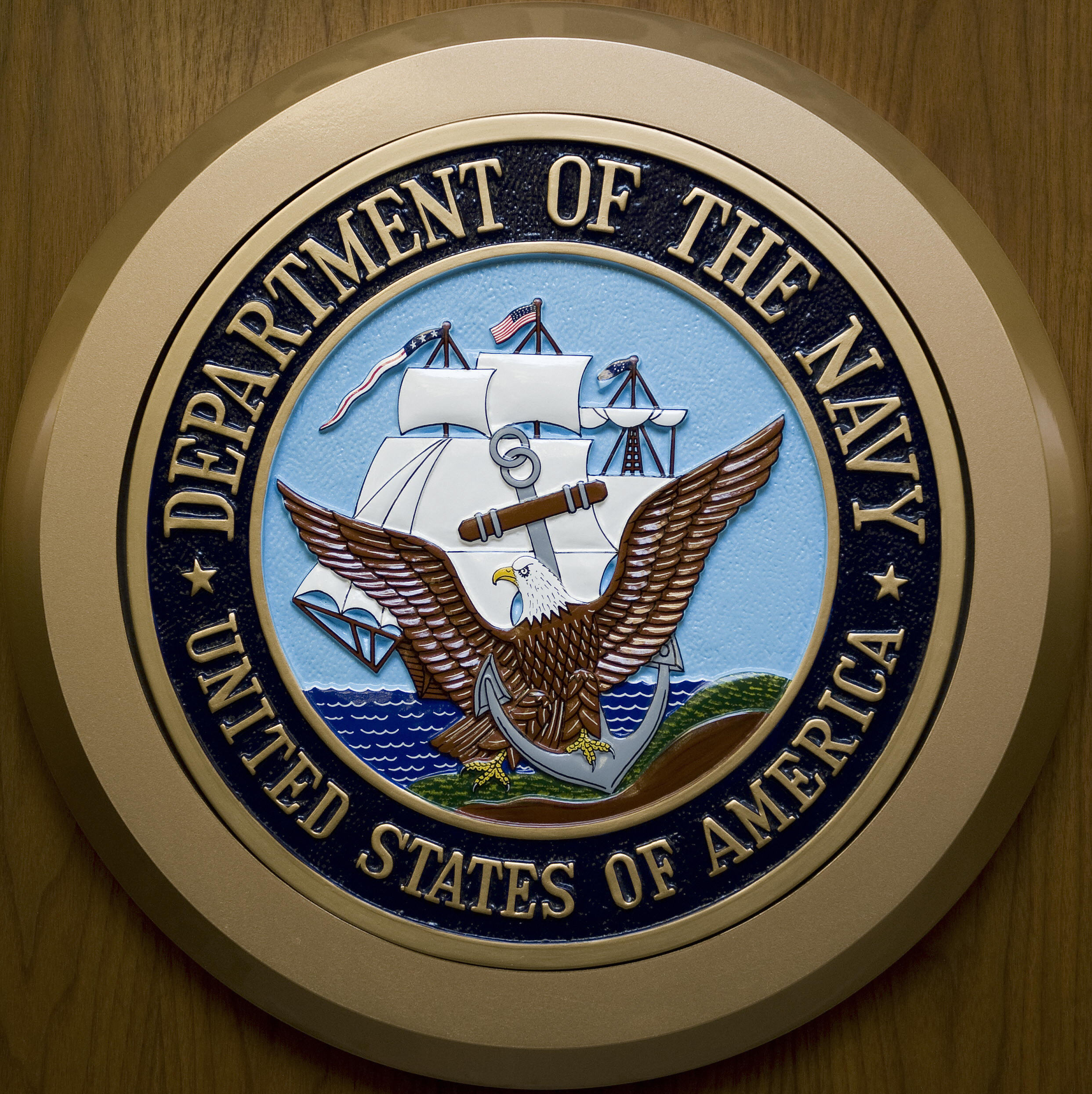 The US Department of the Navy logo hangs on the wall at the Pentagon. (Getty)
