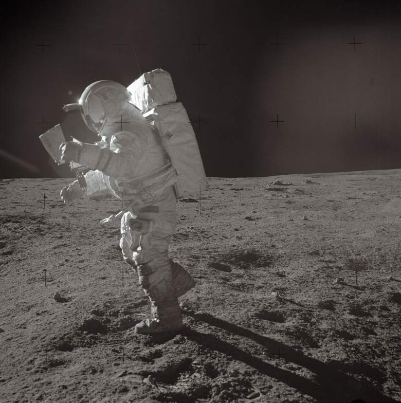 A picture taken on February 6, 1971 shows Astronaut Edgar D. Mitchell, Apollo 14 lunar module pilot, moving across the lunar surface while looking over a traverse map during extravehicular activity (EVA). AFP PHOTO NASA (Photo credit should read -/AFP/Getty Images)